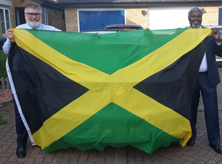 Mayor Dave Hodgson and Councillor Patrick Solomon with the Jamaican Flag