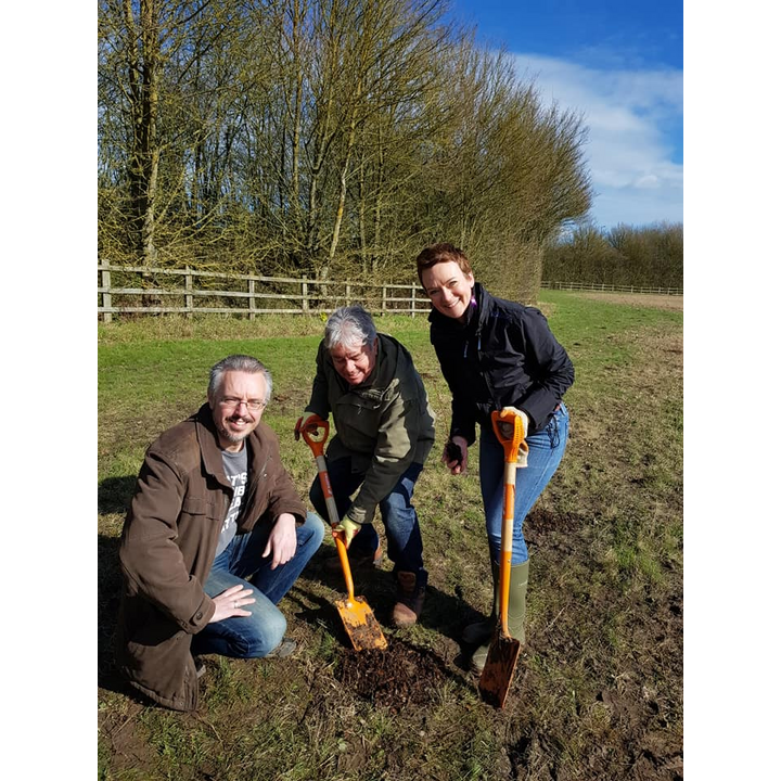 Rose Moore, Mike Mackrory and Richard Lee planting a tree