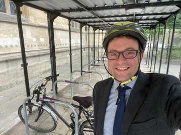 Councillor Henry Vann at the new bike shelter in Bedford Town Centre
